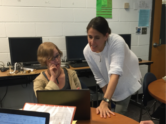 Professor Jennifer Koster assists student Abbigail Traaseth. Photography by Cynthia Beasley