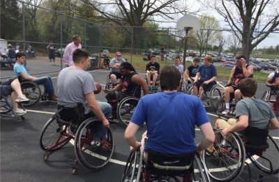 Cardinal player Rush explaining basic rules of wheelchair basketball to PVCC students.  Photograph Courtesy of Susan Hannifan