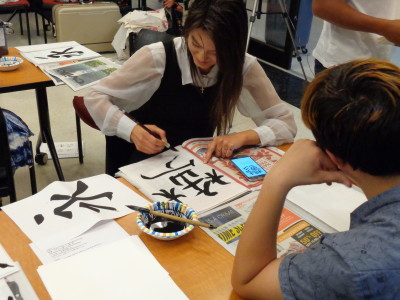PVCC students practicing calligraphy